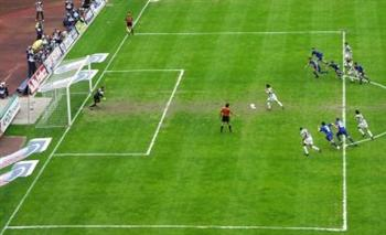 Players from both teams violate the law 14 by entering the penalty area before the ball is kicked.